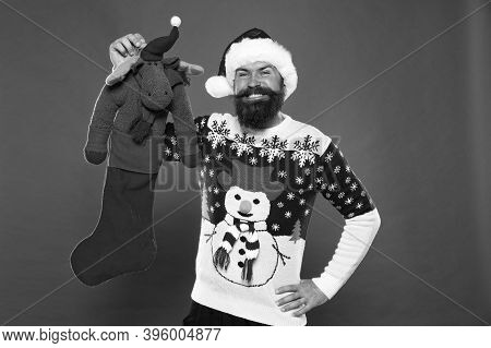 Fun Toy Present. Bearded Man Hold Christmas Present. Happy Hipster Got Present From Santa. Christmas
