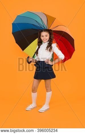 Autumn Look. Little Schoolchild Holding Colorful Umbrella For Autumn Weather On Yellow Background. S