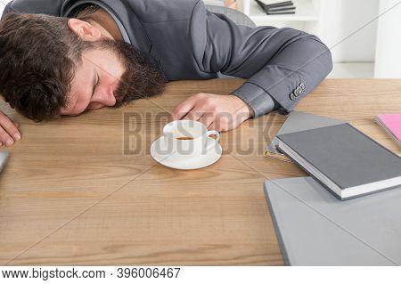 Tired Businessman Sleep In Office. Boss Fell Asleep On Table. Man Sleeping Over Workplace. Coffee Wi