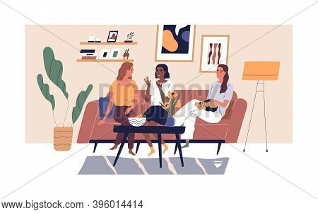 Happy Smiling Girlfriends Sitting On Comfy Sofa Or Couch At Cosy Home. Three Diverse Multiethnic Wom
