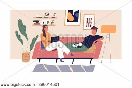 Young Happy Couple Relaxing On Comfy Sofa In Living Room. Spending Time Together In Apartment. Woman
