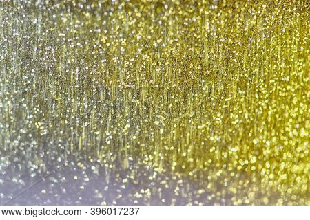Blurry Yellow Bokeh Background, Christmas And New Year Holidays Background. Abstract Background With