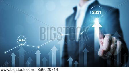 Businessman Pointing Arrow Graph Corporate Future Growth Plan. Business Development To Success And G