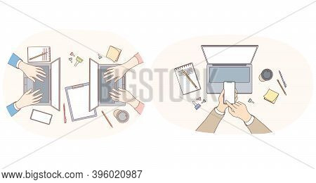 Working With Electronics And Gadgets Concept. Hands Of Office Workers Typing Texts Making Presentati