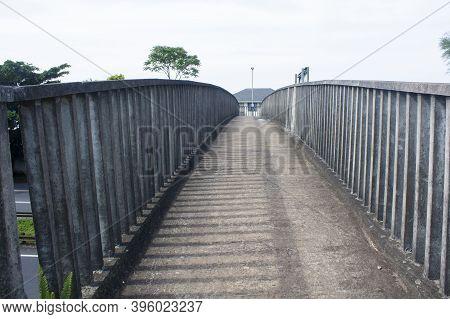 Arched Concrete Pedestrian Foot Bridge With Palisade Railing