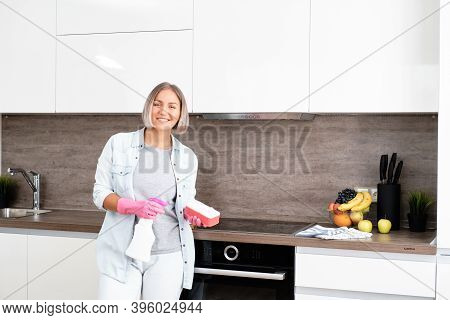 Woman Doing Cleaning Kitchen. Washing A Kitchen. House Cleaning