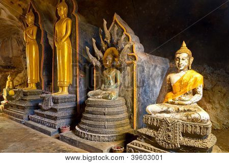 PHANG NGA, THAILAND - NOV 8: Wat Tham Suwan Khuha cave. This natural temple with several large standing and sitting Buddha statues is a tourist attraction in Phang Nga, Thailand on Nov. 8, 2012.