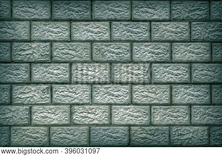 The Wall Of The House Is Made Of Concrete Blocks. Aged Blue-green Tinted Background Or Wallpaper Wit
