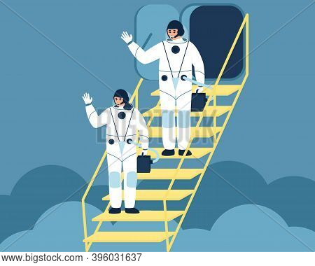 Astronauts Woman And Man Climb The Stairs To The Spaceship. Farewell Of The Astronauts To The Earth.
