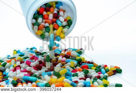 Pouring Antibiotic Capsule Out Of Plastic Bottle. Antibiotic Drug Resistance Concept. Antibiotic Dru