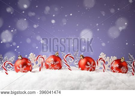 Christmas Balls, Snowflakes And Candies In A Snowdrift