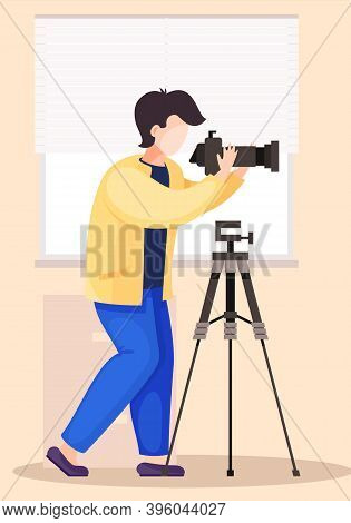 The Guy Standing And Adjusting The Lens. Photographic Art. A Cameraman Prepares Camera For A Photo S