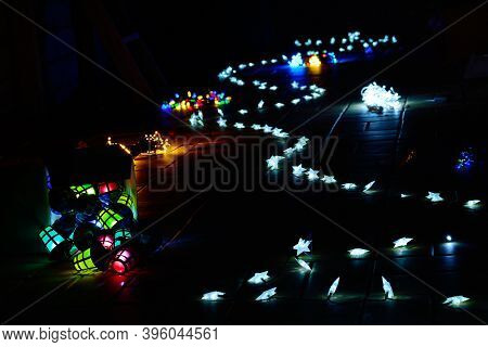 Christmas Lights Form A Path In The Dark. Concept Of Holidays Season, Magic