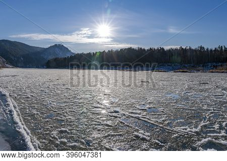 Freezing Mana River, Ice And Sludge On The Water. Beautiful Nature Of Siberia
