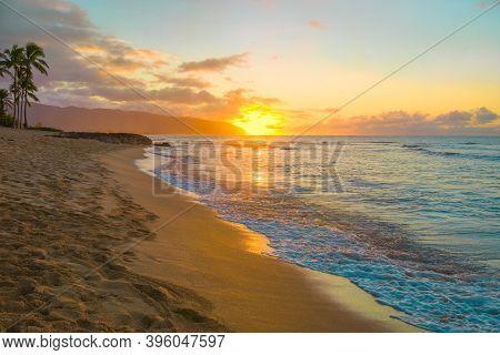 Beautiful Colorful Tropical Hawaiian Sunset Or Sunrise On Beach In Haleiwa, Oahu, Hawaii