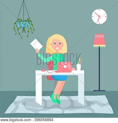 Young Blonde Woman Sitting At Table And Using Laptop. Quarantine Distance Work. Freelance Work At Ho