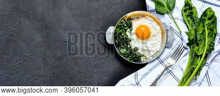 Fried Eggs With Spinach On Iron Pan Plate. Fried Eggs Breakfast With White Towel And Spinach Leaves,