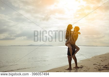 Silhouette Young Man And Girl Couple Romantic Embrace And Kissing Love Leisure In Celebration Before