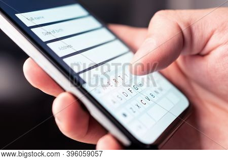 Online Form To Register Personal Info And Data To Web Site With Mobile Phone. Person Typing Informat