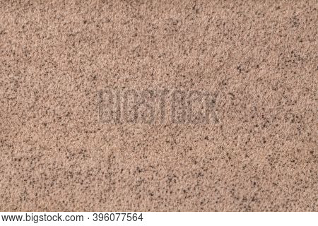 Light Brown Fluffy Background Of Soft, Fleecy Cloth. Texture Of Beige Wool Textile Backdrop, Closeup