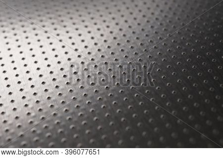 Dark Industrial Metallic Background Or Wallpaper. Perforated Aluminum Surface With Many Holes. Perfo