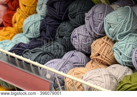 Counter In Shop For Knitting And Needlework With Coils Colored Wool Yarn. Different Color Threads On