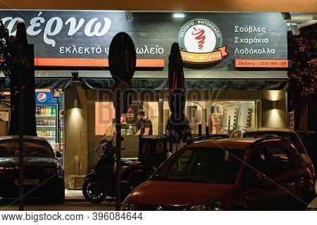 Thessaloniki, Greece - November 20 2020: Hellenic Empty Gyros Shop Without Crowd. Illuminated Night