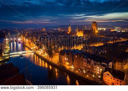 Amazing cityscape of Gdansk over Motlawa river at dusk, Poland