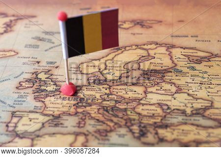 Belgium Marked With A Flag On The Map. Flag Of Belgium On The World Map.