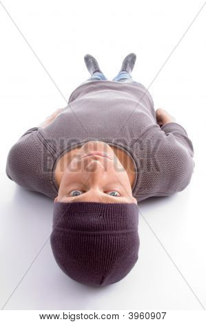 Man Lying On His Back And Looking At Camera