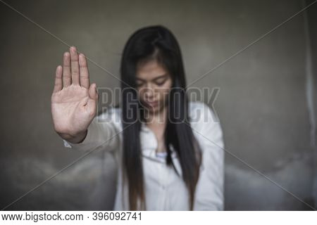 Woman Raised Her Hand For Dissuade, Abuse, Campaign Stop Violence Against Women. Stop Sexual Harassm