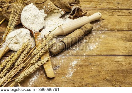 Flour In Sacks, Ears Of Grain, Spoons And Wooden Rolling Pins