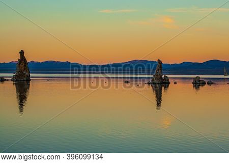 Magic sunset on the lake. Mono Lake is a salt lake in California. Lime-tuff towers of bizarre shapes rise from the bottom. Magnificent reflections of tuff outliers in lake water.