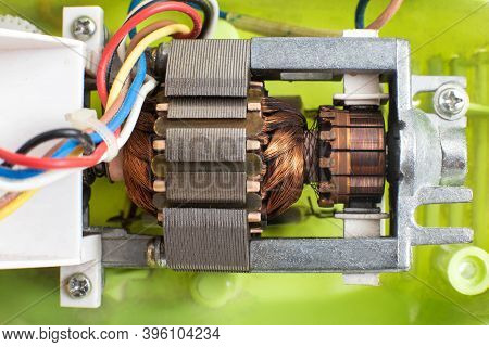 Broken Electric Motor In A Household Appliance Hand Mixer. Malfunction Of The Rotor And Stator Of El