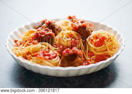 Close Up Of Plate Of Rustic Italian American Meatball Spaghetti Tomato Sauce Comfort Food