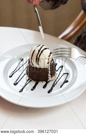 Ice Cream And Brownie Served On A Plate For Dessert