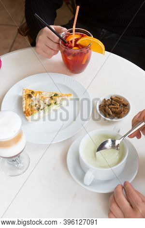 Women Having Lunch In A Cafe With Coffee And Drinks
