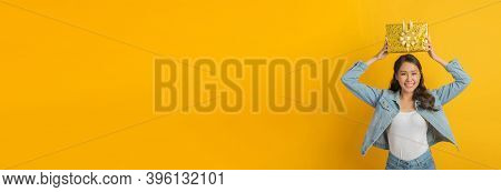 Panoramic Wide Banner. Happy Asian Pretty Woman In Casual Clothing Jeans Smiling And Hold New Year G