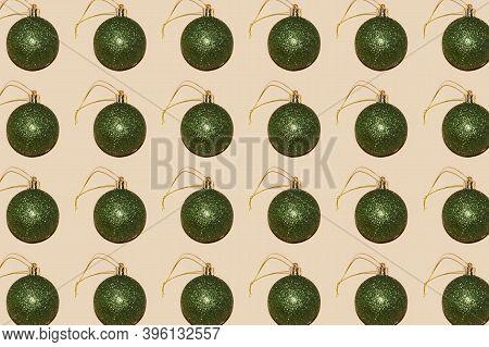 Glitter Bottle Green Christmas Bauble Pattern On Beige Background Perfect Festive Backdrop