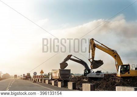 Many Heavy Heavy Industrial Road Construction Machinery On New Highway Road Construction Site Sunny