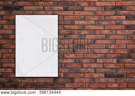 Blank Creased Poster On Brick Wall. Mockup For Design