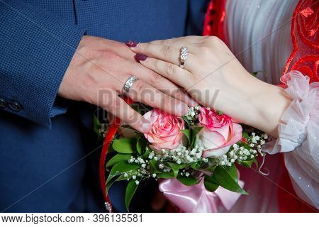 Bride And Groom With Engagement Gold Rings Put Their Hands . The Girl And The Boy Put Their Hands. T