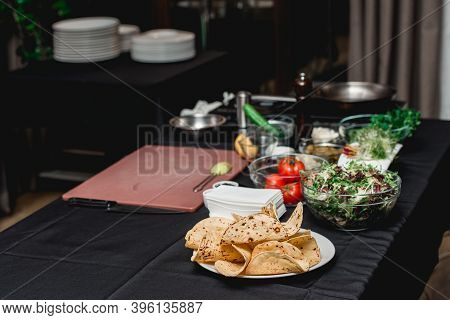 Table With Products For Tacos. The Chef At The Restaurant Is Going To Make Shrimp Tacos With Colesla