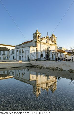 Lagos, Portugal - March 10, 2020: Square Of Lagos City With Cathedral In Water Reflection In Algarve