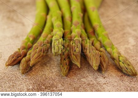 Asparagus. Fresh Asparagus. Bunches Of Green Asparagus On A Brown Background. Top View Image