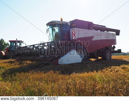 The Combine-harvester For Harvesting Grain Crops. Harvesting Barley. Farm. Large Agricultural Machin