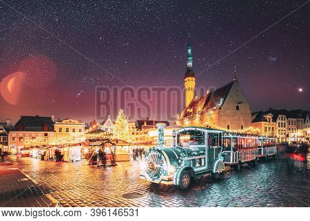 Tallinn, Estonia. Beautiful Train For Sightseeing Near Traditional Christmas Market On Town Hall Squ