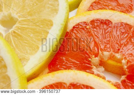 Grapefruit, Orange, Lime, Tangerine, Lemon Slices. The Background Is Made Of Citrus Fruits. Pieces O