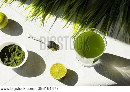 Chlorella Detox Healthy Drink In Glass With Lime And Powder On Light Background. Superfood, Natural
