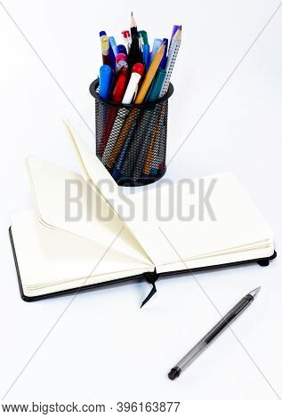 Black Pen, Open Small Unfold Notebook, Note With Blank Empty Light Pages Near Metallic Glass Station